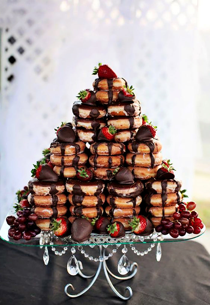 donut tower on silver chandelier cake stand