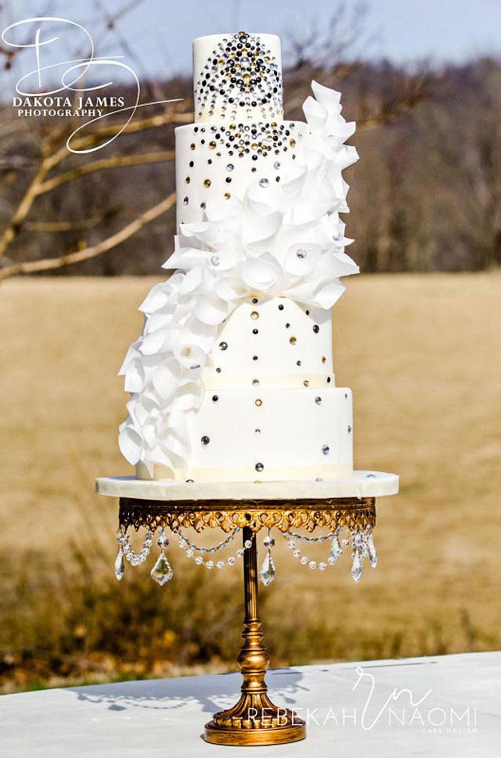 tall tiered bling wedding cake on gold cake stand