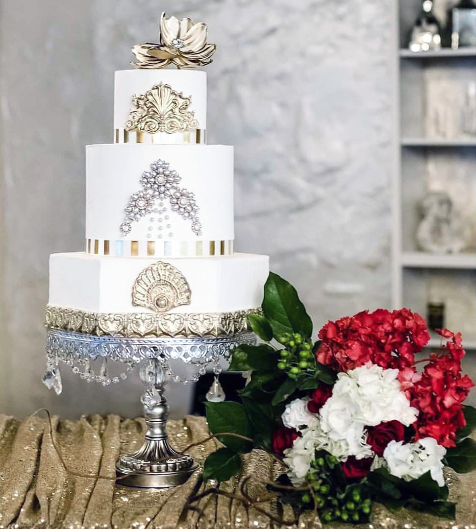 silver and gold embellished traditional wedding cake