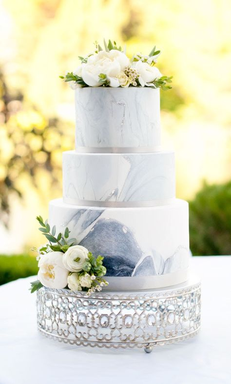 marbled wedding cake on silver cake stand