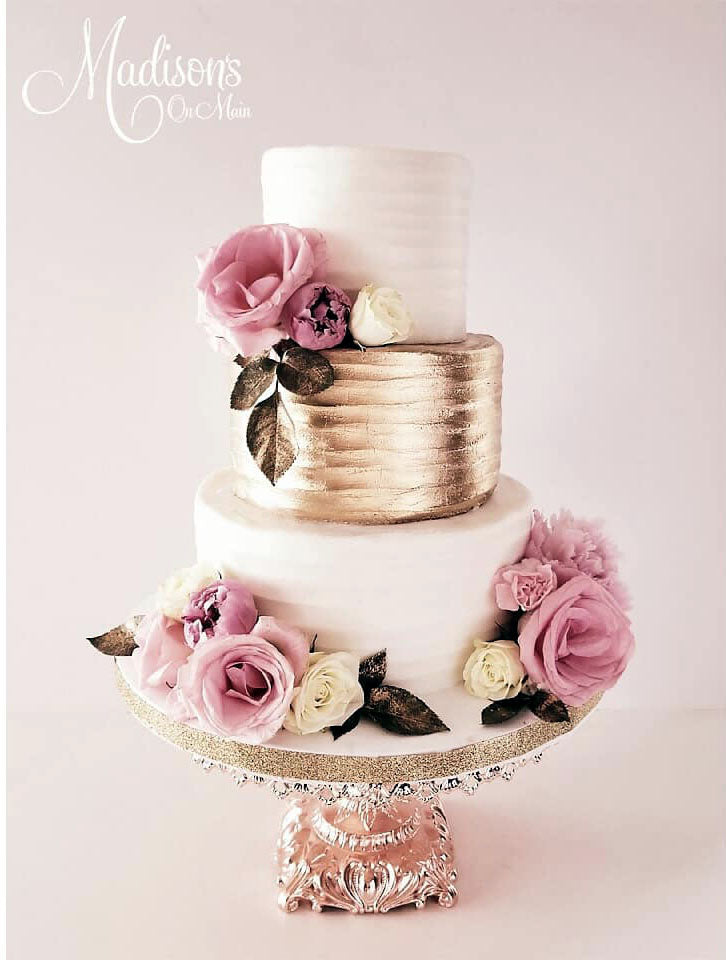 rose gold wedding cake stand and wedding cake with pink flowers