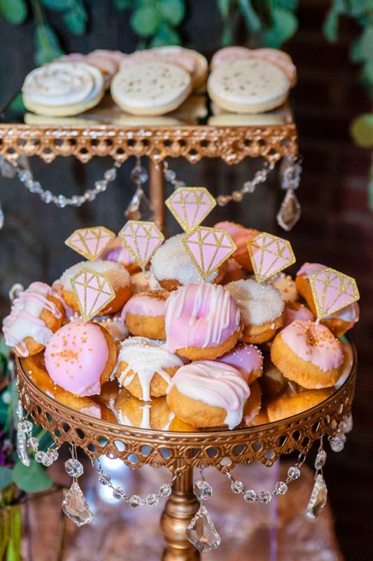 mini donuts on gold cake stands