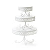 white round metal cake stand set with decorative border and loopy leg base