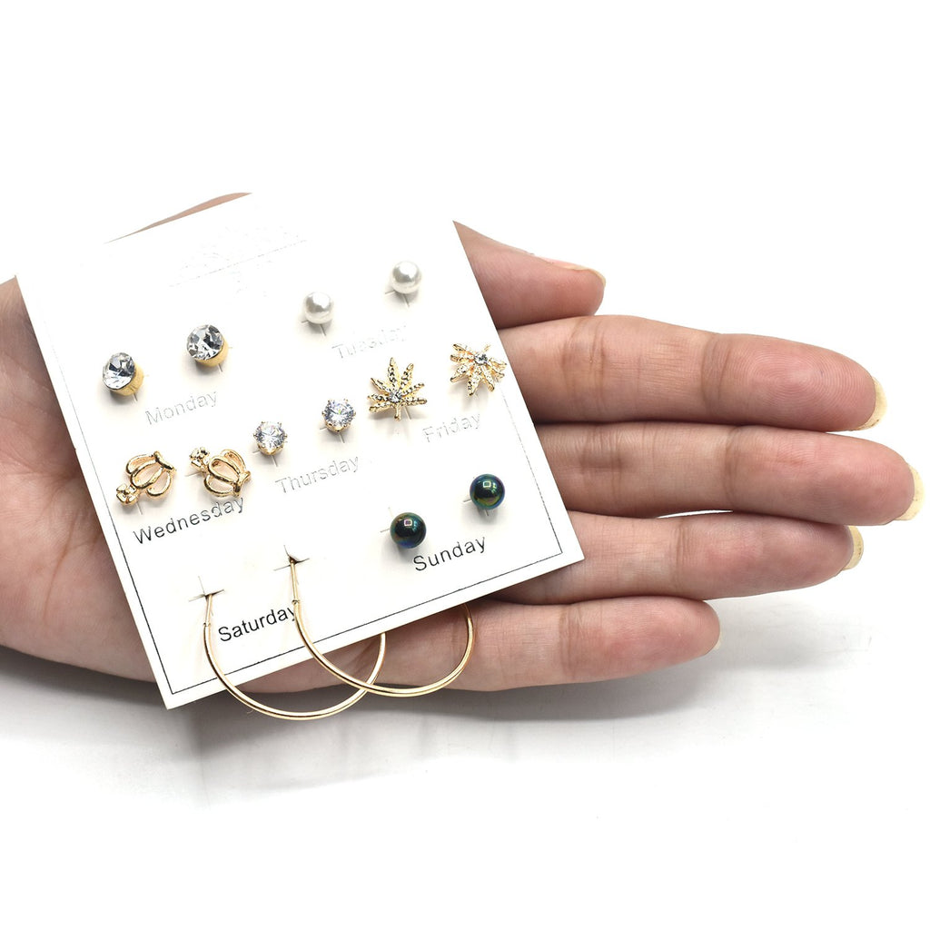 pack of 7 pair stud earrings with rhinestone and acrylic resin flower design in gold tone