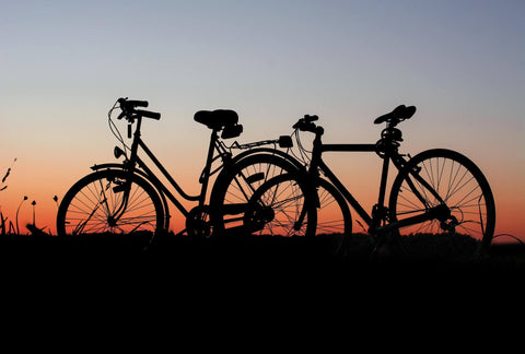 Locked bicycles in the sunset