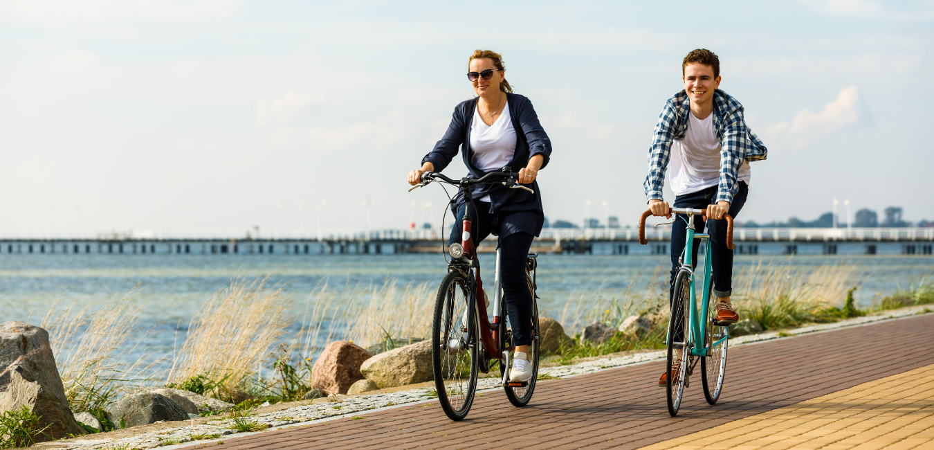 Two people on a bicycle biking around