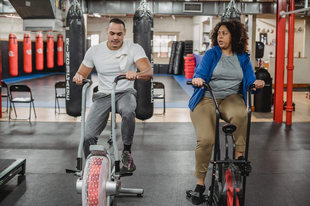 Two people on Bike Trainers