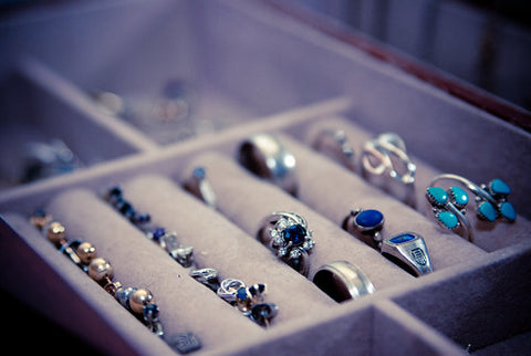 various colors and sizes of rings in a jewelry box