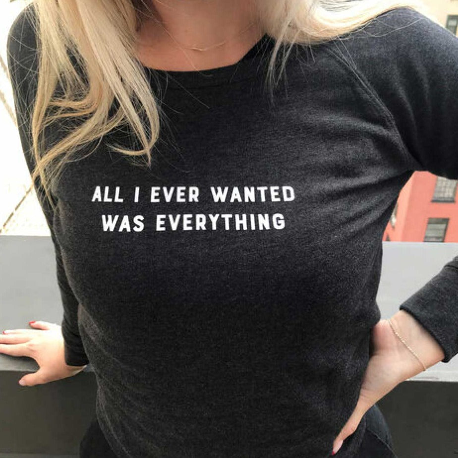 Blonde woman wearing All I every wanted was everything sweatshirt