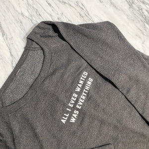 Load image into Gallery viewer, Sweatshirt with text reading All I ever wanted was everything on marble background