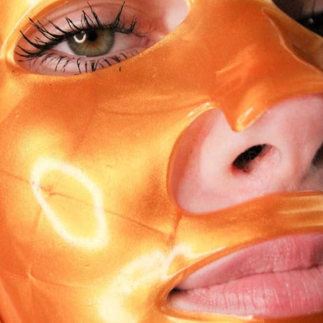 Close up of gold mask on womans face