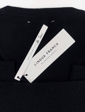 Load image into Gallery viewer, Black folded sweater with lingua franca tag