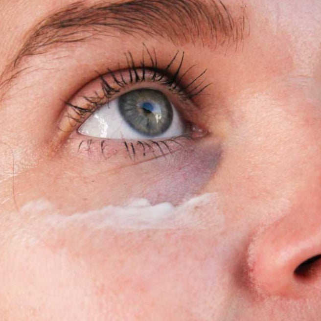 Load image into Gallery viewer, Swipe of eye cream on womans undereye