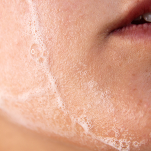 Load image into Gallery viewer, Close up of foaming cleanser on chin
