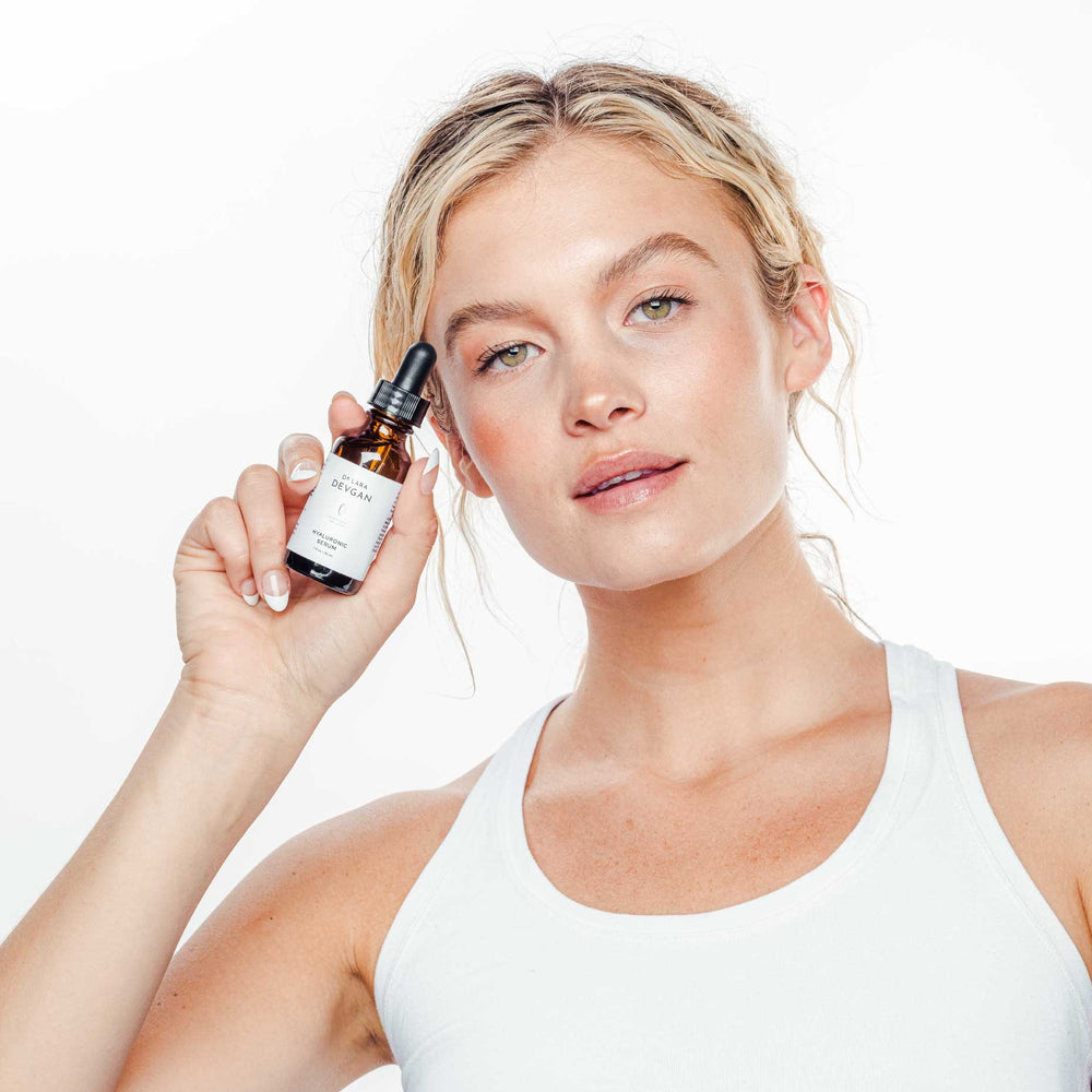 Woman holding hyaluronic serum