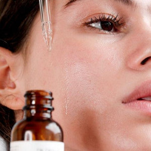 Load image into Gallery viewer, Woman dropping Hyaluronic Serum onto Cheek