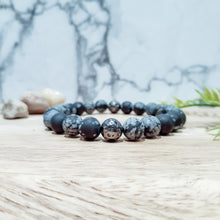 Load image into Gallery viewer, Snowflake Obsidian + Gunmetal Lava Stone Bracelet