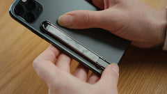 iphone with shiny gunmetal phone accessory