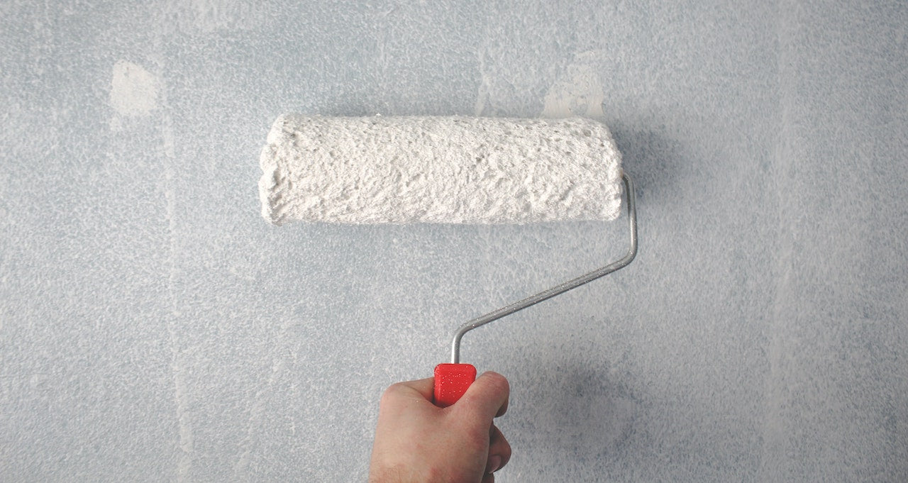 Picture of Person Paint Rolling Wall