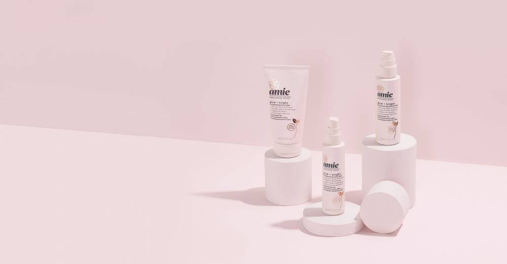 Amie glow and bright collection products displayed against a pink background