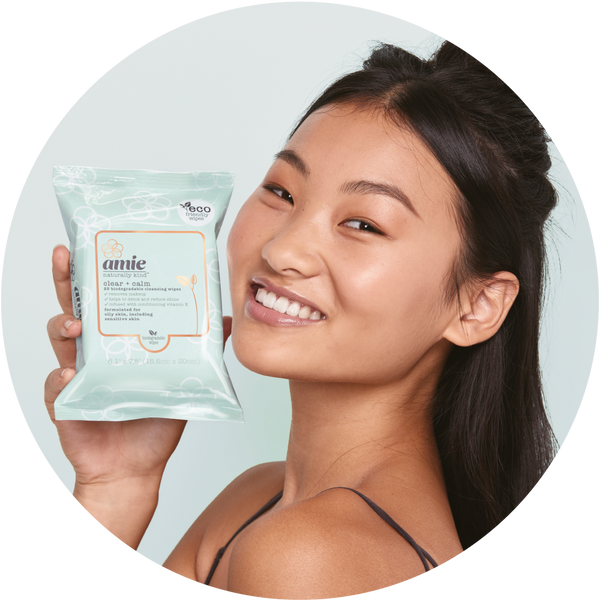 Woman holding Amie clear and calm biodegradable cleansing wipes