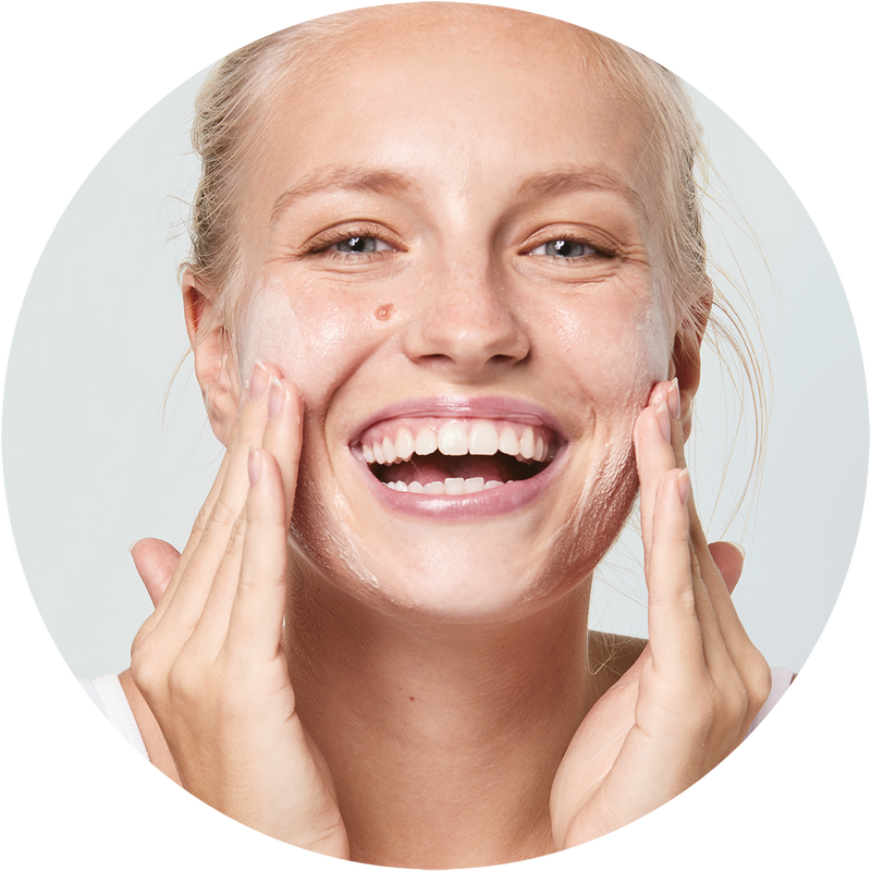 Woman applying Amie's clear and calm exfoliating face wash