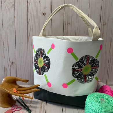 Block printed bag with handles . Bag has waxed canvas bottom. Bright pink dots