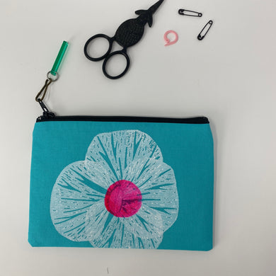 Small zipper bag with block printed white flower with a pink dot