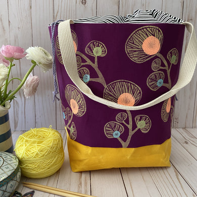 Deep berry cotton printed with block print design.Yellow waxed canvas bottom