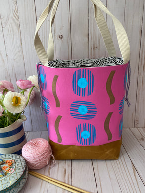 Large Drawstring bag, hot pink cotton block printed with gold squiggles and blue circles. A project bag for knitters
