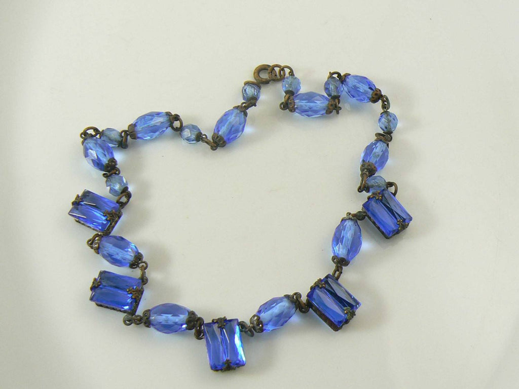 Art Deco blue step glass, brilliant cut glass and brass necklace - Vintage Lane Jewelry
