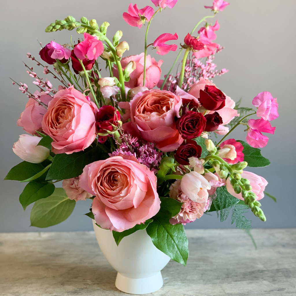 medium sized arrangement of david auston roses, spray roses, sweet pea, ginestra and greenery in small dahlia compote Valentines Day wrapped bouquet Loudoun county local florist near me Valentine's Day  Waterford Virginia, flower shop