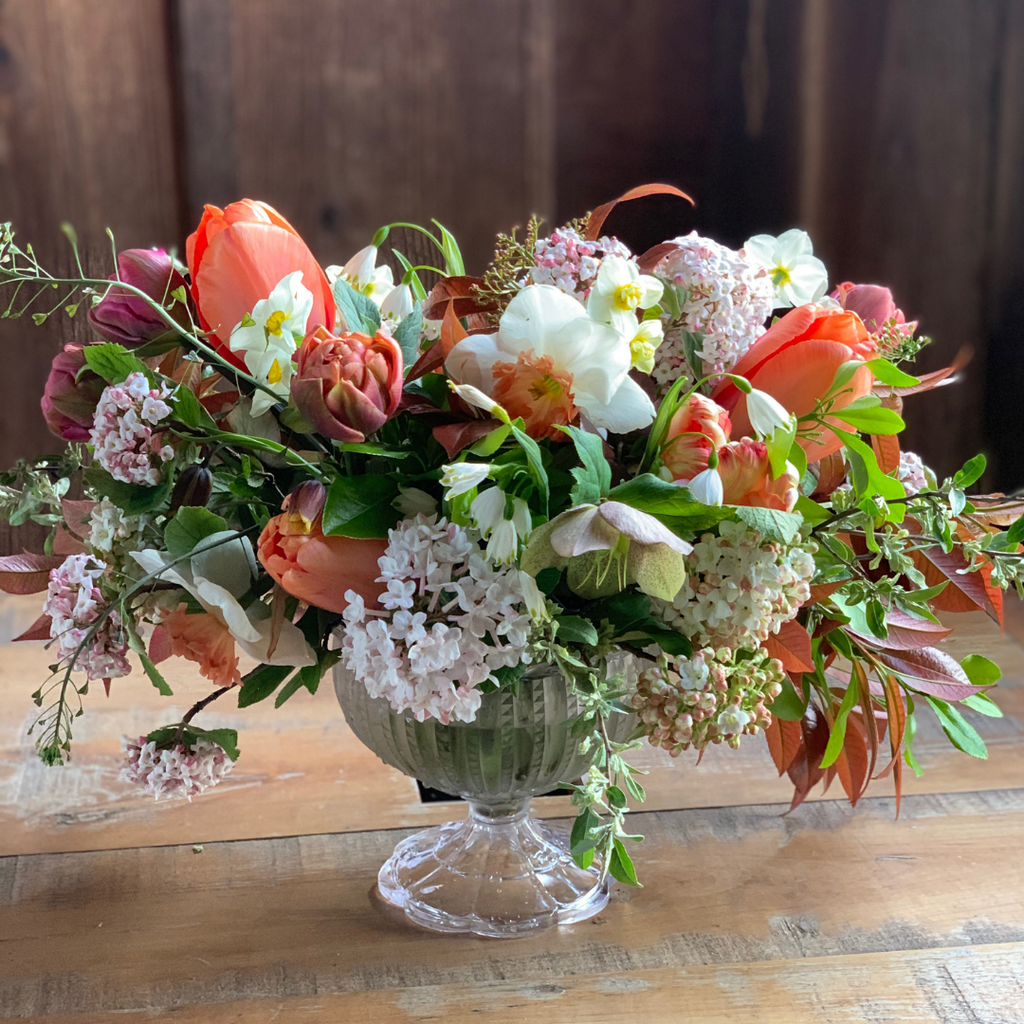 a representation of a desinger's choice centerpiece arrangement using orange tulipsHope Flower Farm Loudoun County local florist near me Waterford Virginia, flower shop