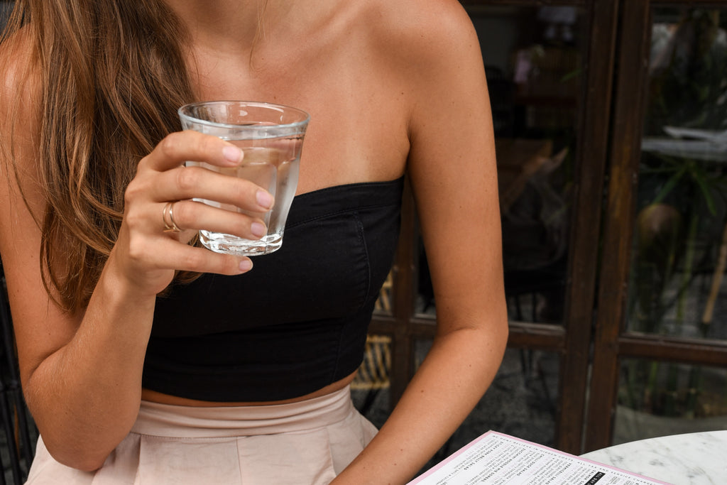 Woman glass water