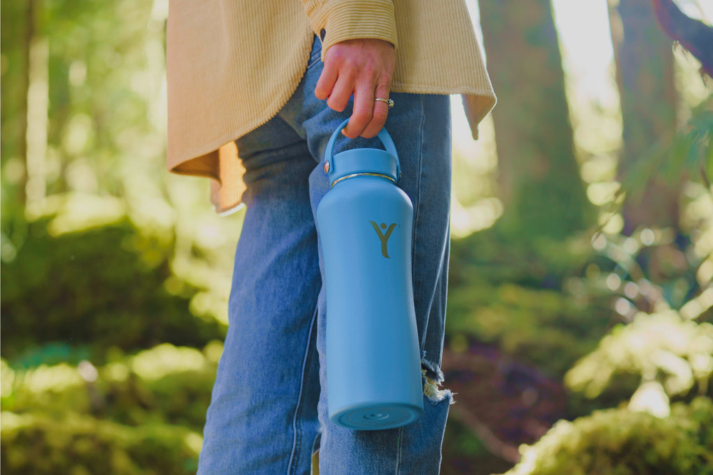 dyln alkaline water bottle outdoors forest on the go