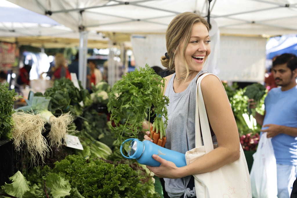 woman buying farmers market