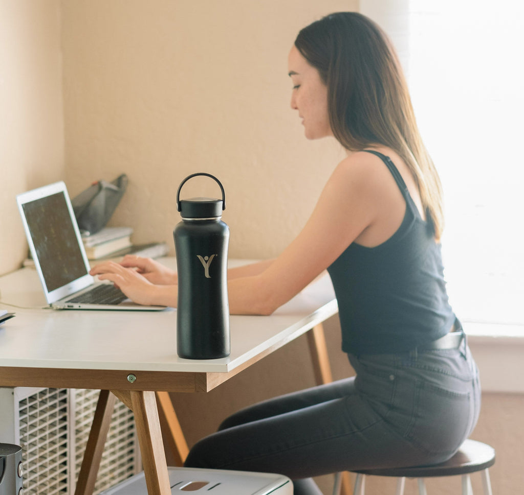 woman working at home black insulated bottle