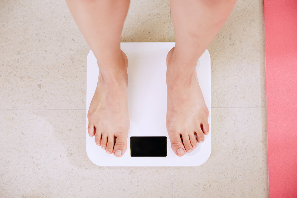 person standing on white digital scale