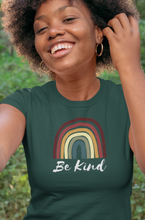 Load image into Gallery viewer, Woman wearing green be kind rainbow t-shirt