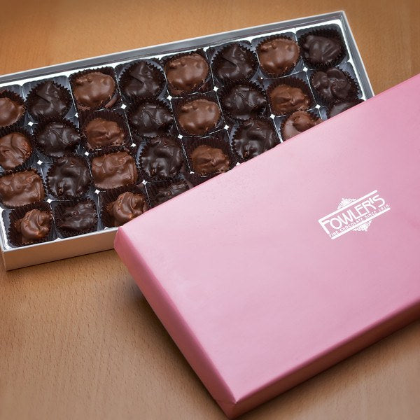 An assortment of nuts with sweet milk chocolate.