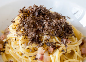 Pasta carbonara with black truffle