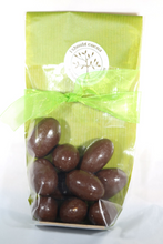 Load image into Gallery viewer, Milk Chocolate covered Brazil nuts.