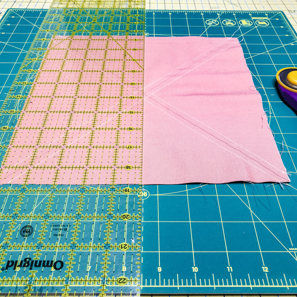 tips for cutting 8 at a time half square triangles, half square triangles, jittery wings, all the good quilt pattern