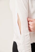 Load image into Gallery viewer, Close up of a white shirt sleeve that has an opening with poppers.