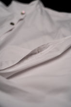 Load image into Gallery viewer, Close up of white cotton shirt sleeve opening with popper tape.