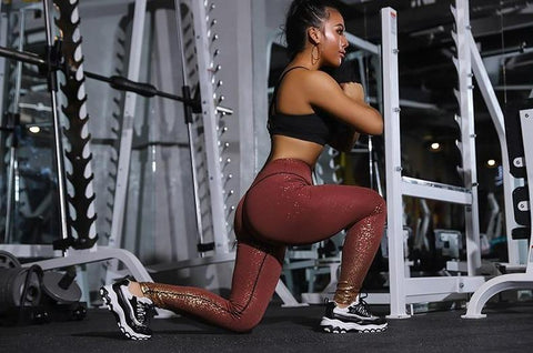 woman in sangria red sparkle fitness yoga leggings squatting working out