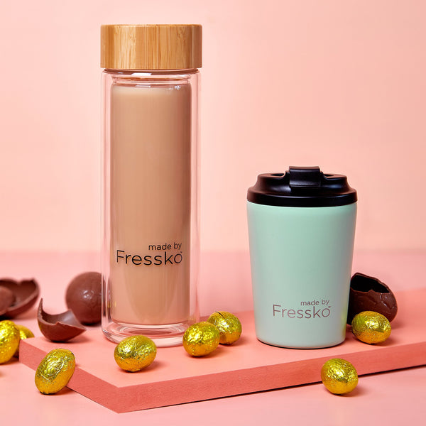 Fressko glass flask filled with mocha and camino coffee cup surrounded with chocolate eggs