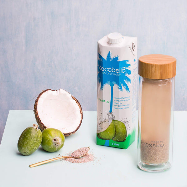 Glass Fressko flask with coconut water coconut and feijoas