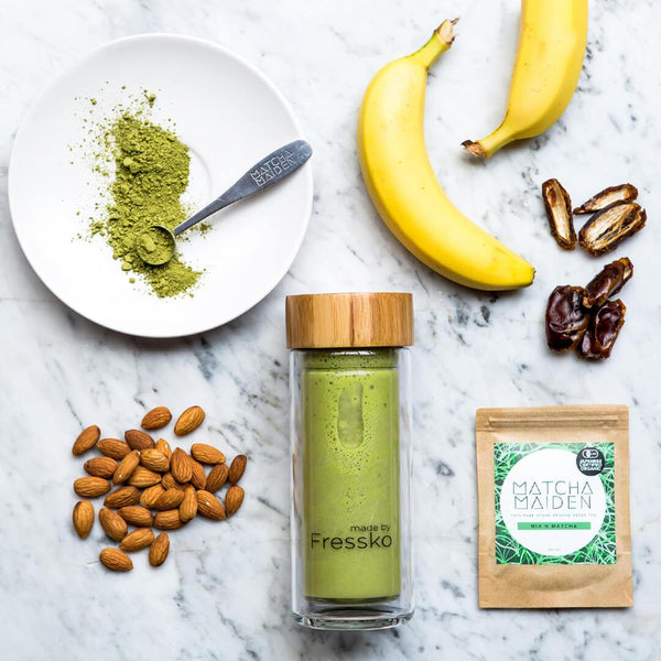 glass fressko flask with matcha banana and date smoothie