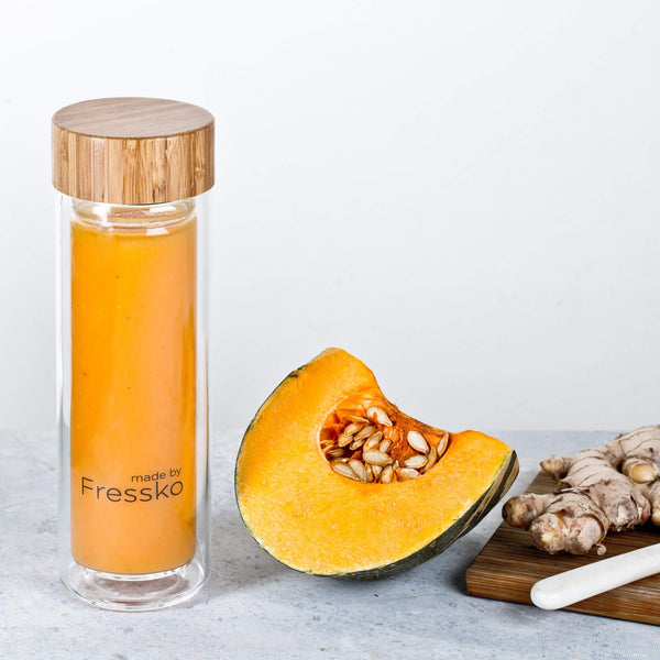 Pumpkin and ginger soup in glass fressko flask with ginger